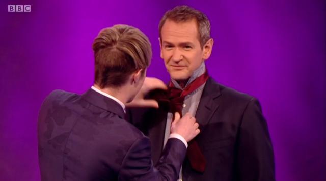 John tying Xander's tie